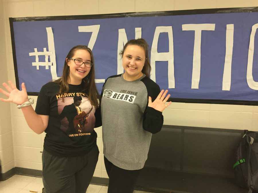 LZ students show their school spirit in the cafeteria. Booster clubs are trying to promote this kind of spirit by fundraising, pumping up student athletes, and handing out spirit wear.