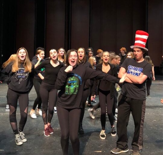 "Griffin Brown, senior who plays Cat in the Hat, watches as other members of the cast preform a musical number. "" [In the Seussical] there are some really interesting relationships between characters and some comedy for everyone,"" Brown said."