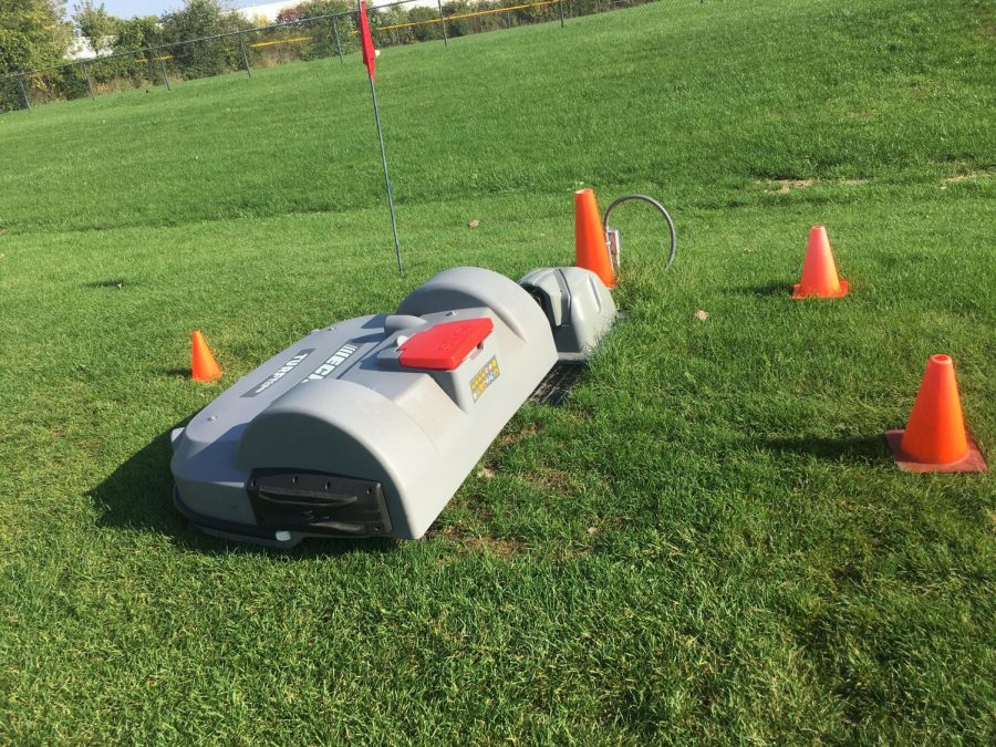 """The lawnmower sits pacientlly, taking a well earned nap before it's next mission. """"[This partner ship with ECHO] is really great because it is a real world experience rather than just learning about engineering in the classroom."""" Cameron Circo, president of robotics club, said."""