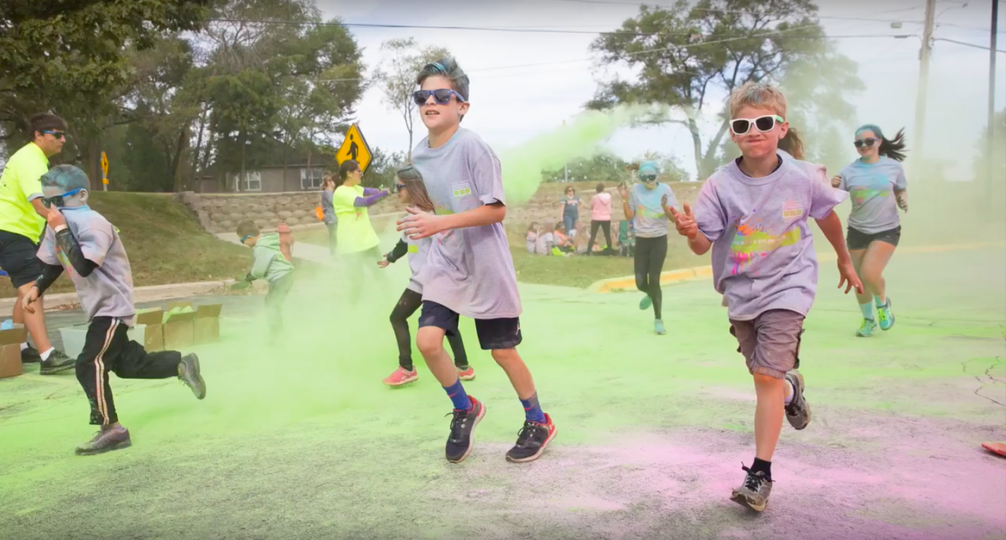 Elementary schoolers dash through colorful powder during last year's Bears on a Color Run. The coordinators of the event hope to draw an even bigger crowd this year.