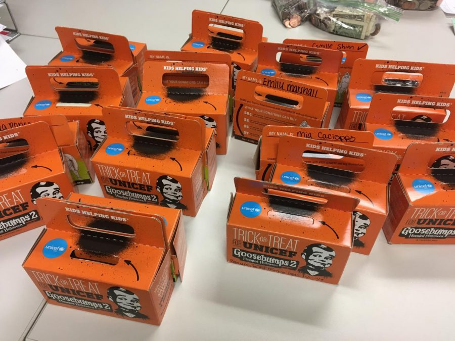 The+orange+%E2%80%9Ctrick-or-treat%E2%80%9D+boxes+that+students+collected+money+in+as+part+of+UNICEFS+first+fundraiser.+Profits+from+fundraisers+like+these+will+go+towards+helping+UNICEFS+cause.
