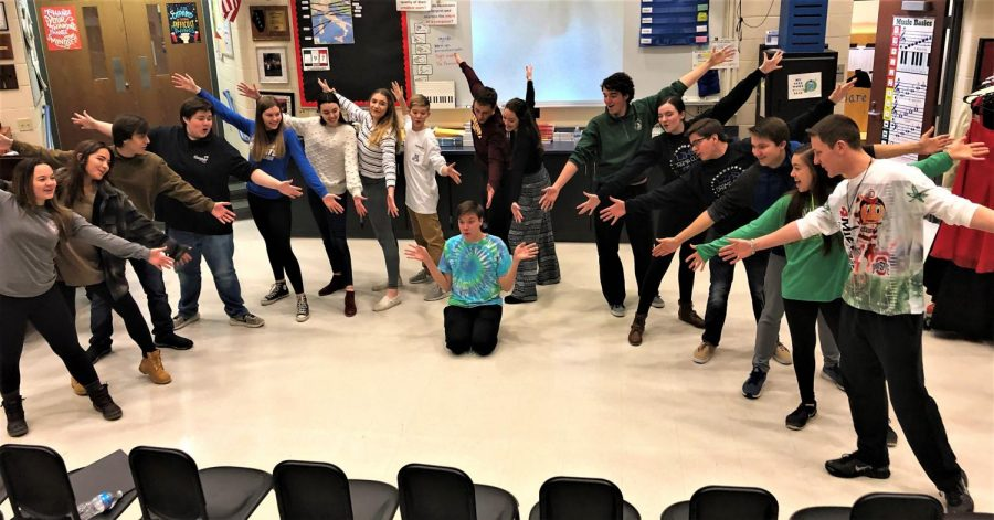 Bare Voices strikes an ending pose as they rehearse for their holiday performances. According to Nick Juknelis, Bare Voices teacher, it is this valuable practice time that allows the gorup to spread goodwill around the community.