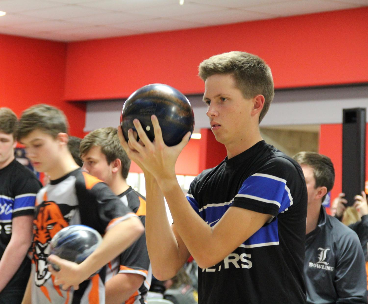 Jason Czabaj, senior, prepares to take a shot in a match. Competitive bowling requires a skill and focus some people may not recognize, according to Schnur.