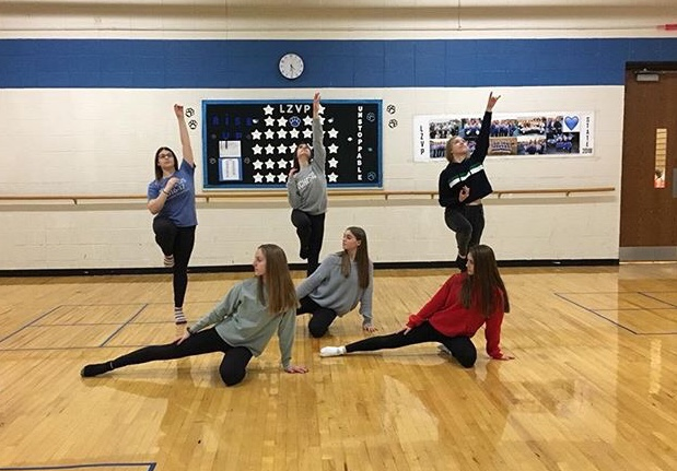Members of orchesis practice their routine for Winter, Fire, Snow. According to Cora Meagher, junior orchesis member, the team has been working hard on this piece in order to showcase it at the choir concert on Wednesday.