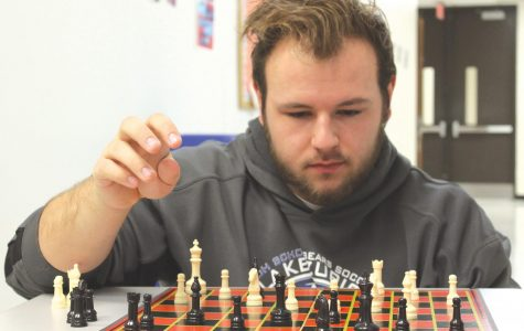 Robert Mepham, senior, thinks through his next chess move.  For him, the game is a mental challenge that he enjoys and that keeps his mind sharp.