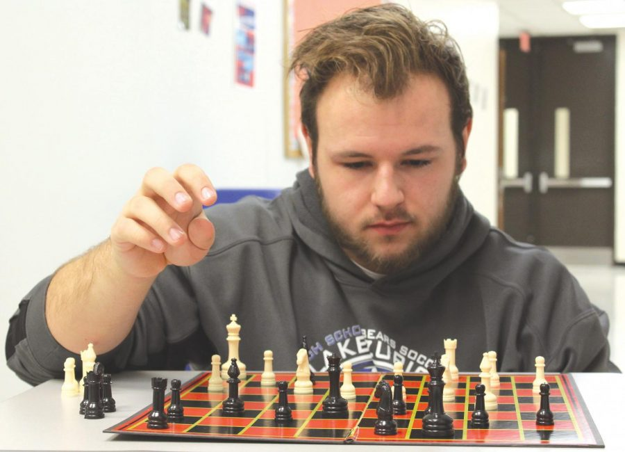 Robert+Mepham%2C+senior%2C+thinks+through+his+next+chess+move.++For+him%2C+the+game+is+a+mental+challenge+that+he+enjoys+and+that+keeps+his+mind+sharp.