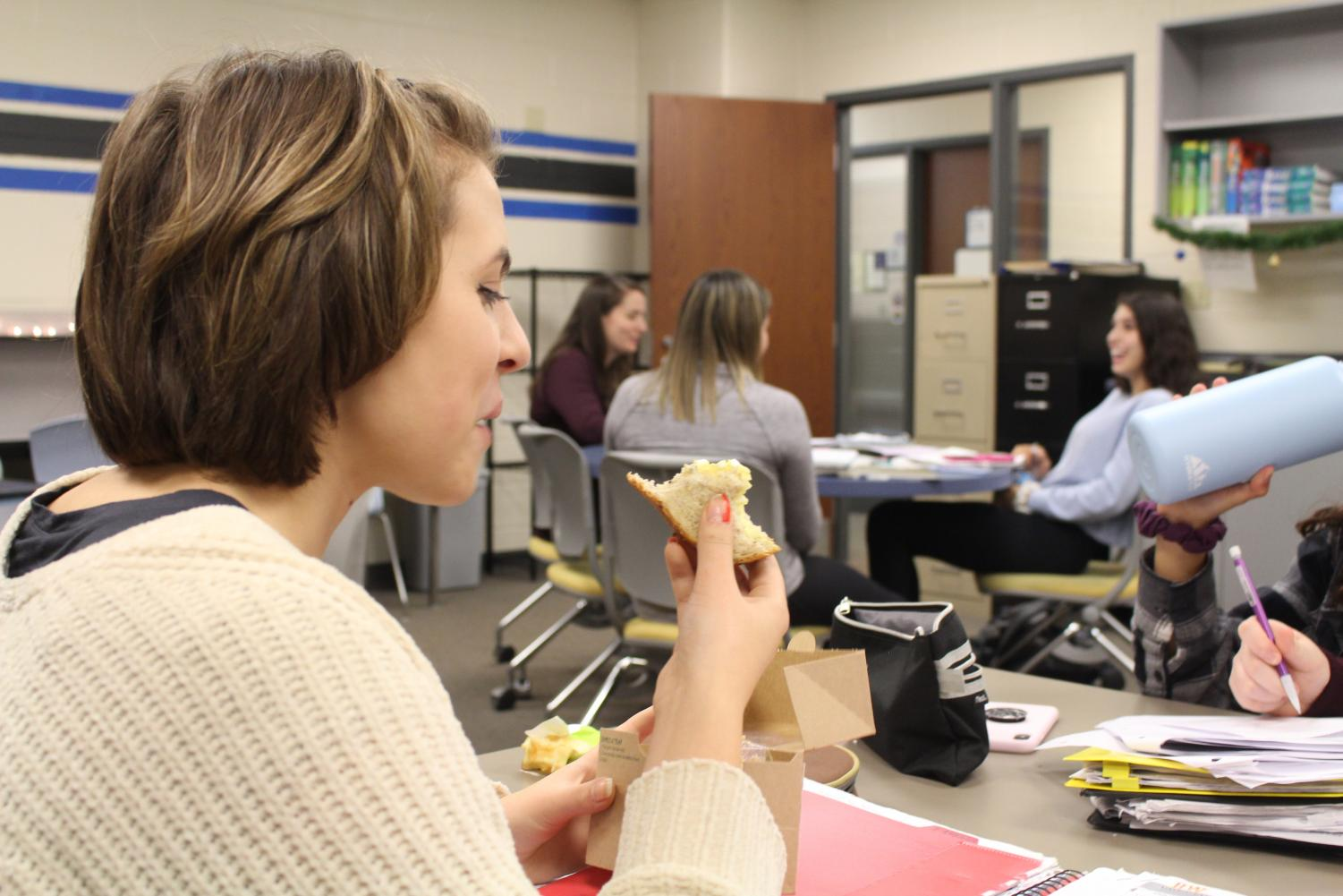 McKenna Kalesz, sophomore, eats an egg salad sandwich from the school cafeteria. This is just one of the vegetarian options students can find for lunch at the school.