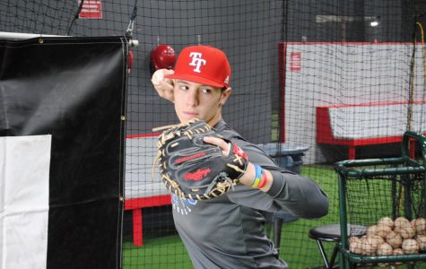 Tyler Snep, senior, gears up to practice throwing the ball down to second from home plate. Snep's pop time, or the time from when the pitch hits his glove to when it is thrown down to second base, is  1.96-2.01 seconds