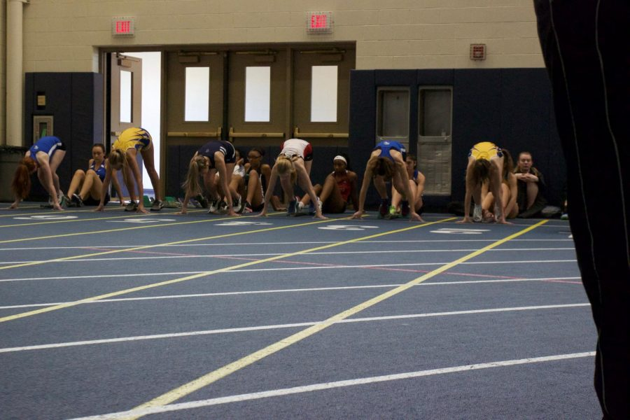 A couple members of the girls track team prepare to start their race at the Lyons Invite on February 9. The team this week will prepare to compete in the Wheeling Invite on February 23.