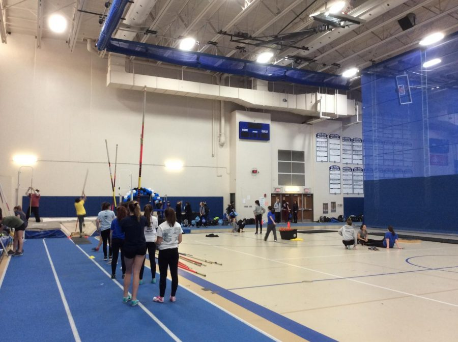 Girls track members practice together after school. The indoor season is a huge component in preparing for the outdoor season, according to Kauffman.