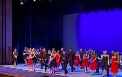 Blue Notes and Bare Voices perform a holiday song together during last December's concert. The group will meet up onstage again this Thursday with a new concert theme.