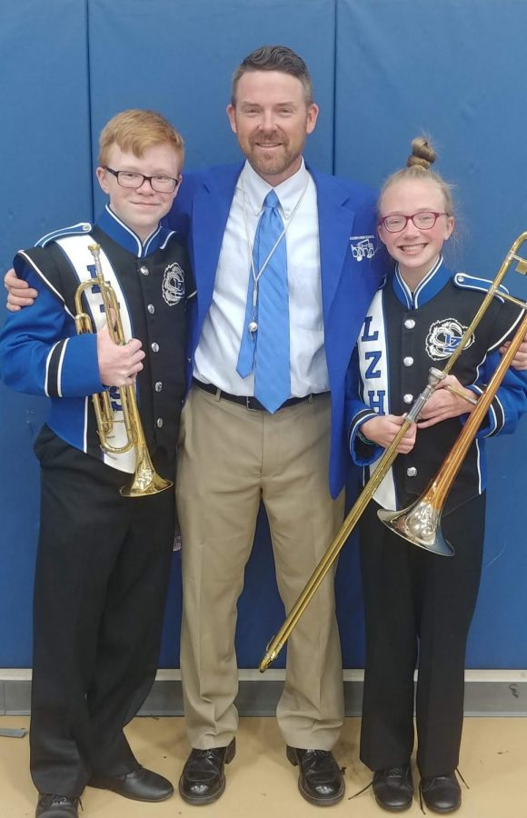 The Thompson family holds a strong love and passion for music. (From left to right) J.T. Thompson, junior; Josh Thompson, band director; and Kate Thomson, freshmen, come together as a family to perform their music.