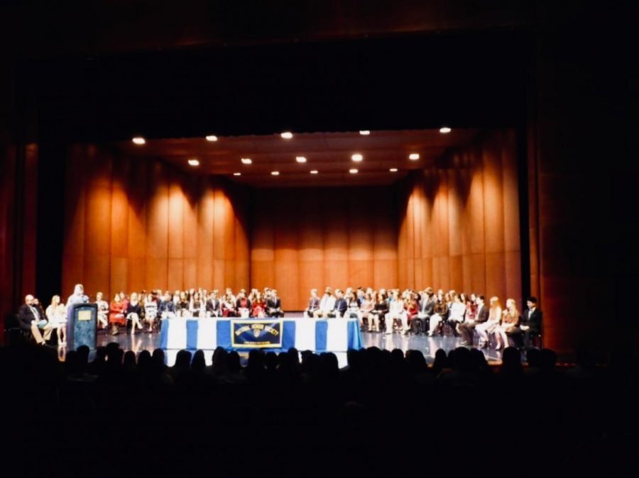 Students are initiated into NHS at the induction in March 2017. For the 2019-2020 induction, 92 students will be on stage for the ceremony, ready to be inducted into NHS.