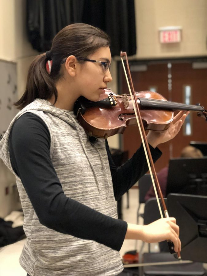 Olivia+Reiff%2C+senior%2C+practices+her+solo+piece+for+the+upcoming+Solo+%26+Ensemble+competition.+Student+musicians+like+Reiff+have+been+preparing+for+months+in+order+to+have+the+best+shot+at+going+to+the+honors+recital+in+April.