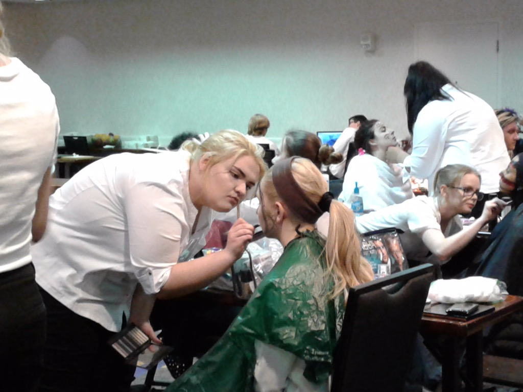 Cosmetologists work on their models' makeup at Skills USA. Caroline Clouse, junior, who participated in this event,. said that it was very interesting to see what other artists were doing, and that one of the participants