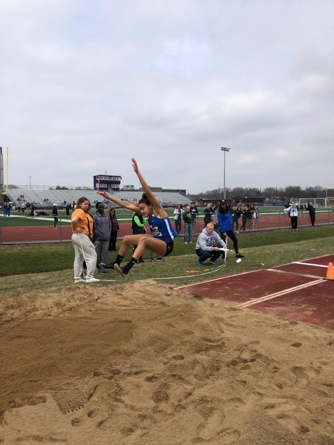 Nikki Skoby, senior, competes in the long jump at the Buffalo Grove Invitational. Skoby took fourth in the event, and the team took second place overall at the invite.