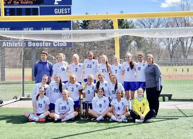 The girls soccer team poses with the trophy after winning the Prospect Tournament on Sunday. The team went 4-0 in the tournament to capture the title.