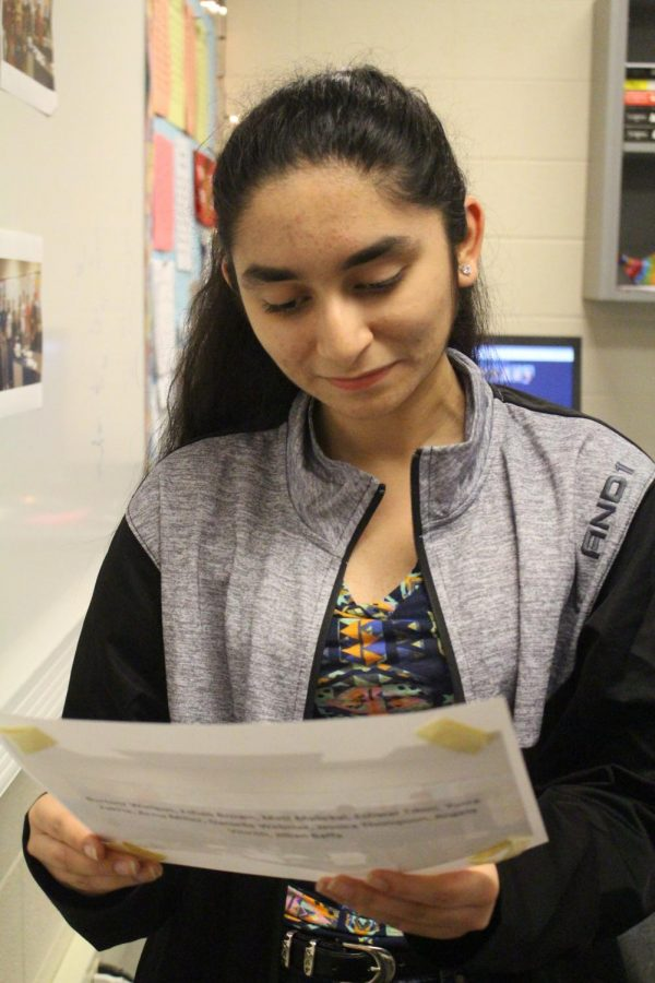 Yusra Zakria holds an old photo. Zakria says that reflecting on her negative experiences has helped her make decisions for the future.
