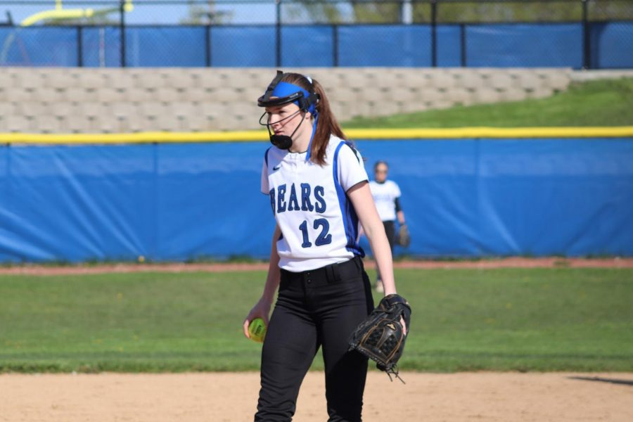 Maura Ginn, sophomore, stares down towards the plate and prepares to pitch during a May 13 game against Mundelein. Sad the team's season ended this past week, but the team will now look ahead to next year.