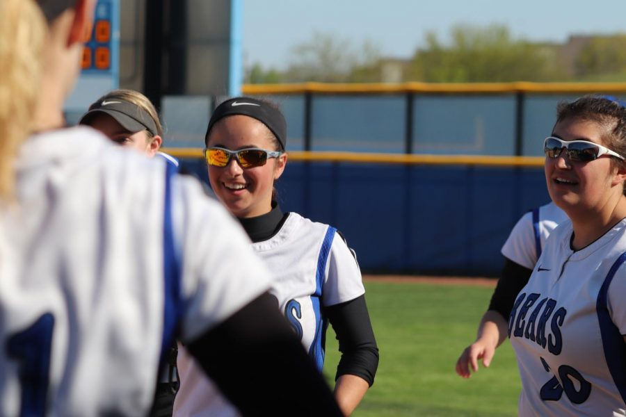Nina Kolb, sophomore varsity softball player, cheers on a teammate during a game. Players such as Kolb work hard to help the Softball program gain fans and recruits, but feel as if the program is often overlooked.