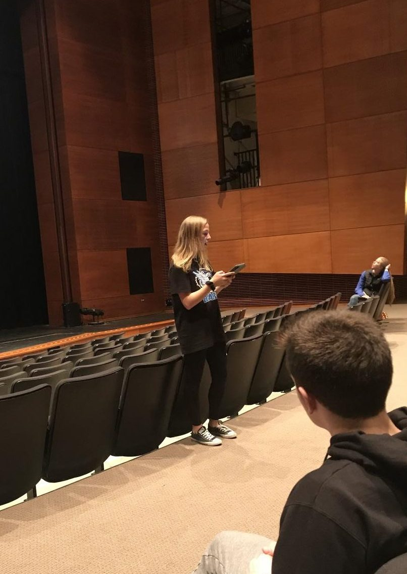 Charity Bash selections include Student Council members presenting potential charities to other club leaders. Maeve Griffin, junior, is shown presenting a potential charity for Charity Bash.