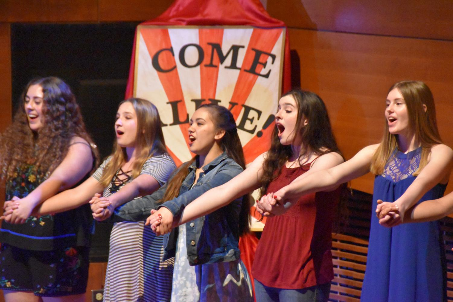 Members of Kalideoscope perform a finale together at the end of the show.