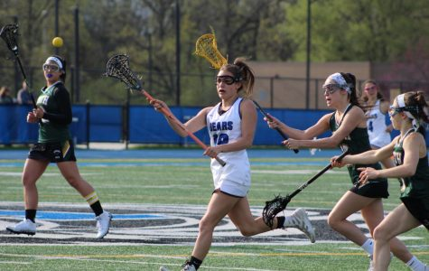 Emilia Mangiardi, sophomore, passes the pall down field in a game earlier this year against Glenbrook North. The team will be heading into Sectionals this week