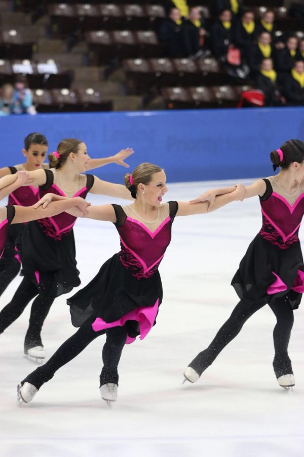 Cori Robinson, junior who figure skates at a facility in Buffalo Grove called Twin Rinks, performs a synchronized skating routine.