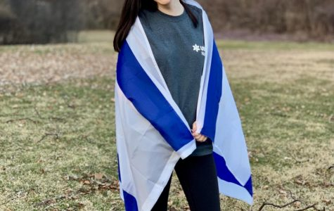 Elana Redfern, senior, poses with an Israeli flag. Next year, rather than going immediately to college, Redfern will spend nine months in Israel to learn the culture and help out in less developed areas.