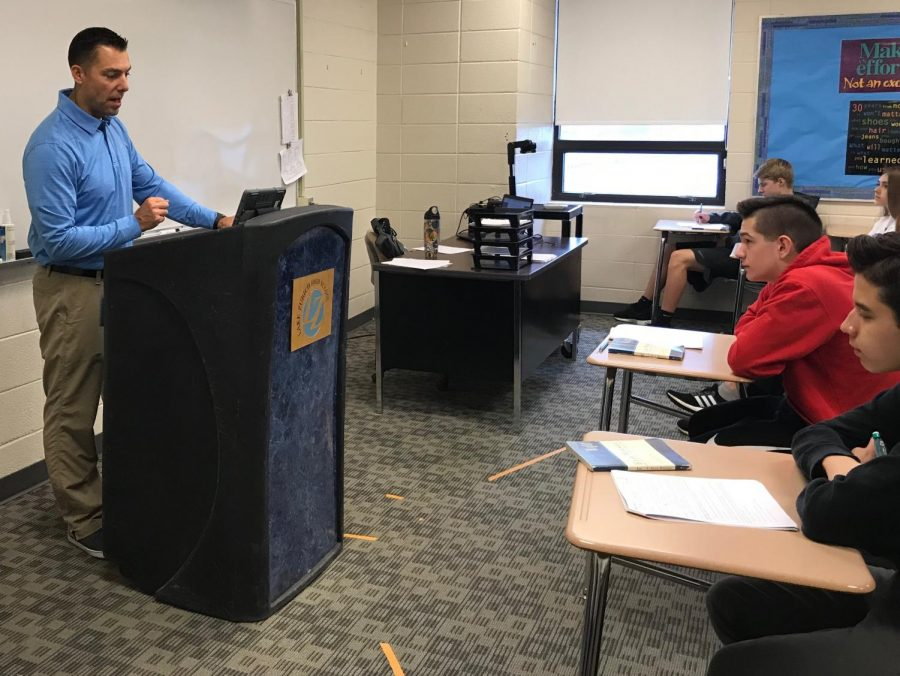 Luke Mertens, football coach and English teacher, can often be seen on the second floor instructing his students on Shakespeare or any number of other literary works. With Mertens leaving next year, their new English teacher will have to step into his role as a mentor.