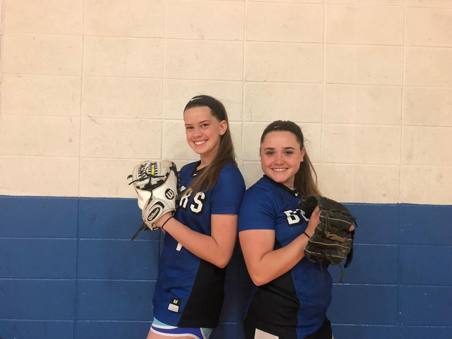 Seniors and best friends, Haley Gajewski and Julia Zaucha, pose for a photo in their softball gear. The two girls have been teammates since middle school.