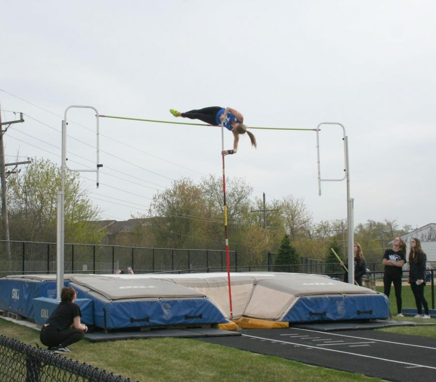 Kelsey Rothas, junior, clears the bar in pole vault at the Lake County Invite on Thursday. Rothas ended up winning the event.