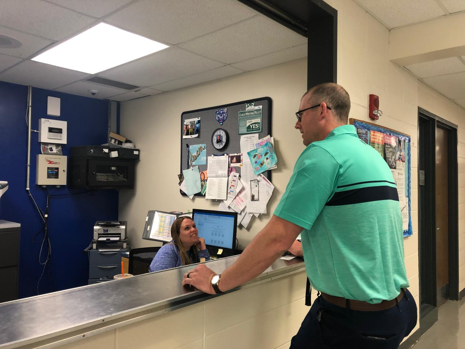 Jeretina stops by the bookkeeper's office as he checks in on all the staff in the morning. Along with the teachers in the building, he will also email the online teachers just to