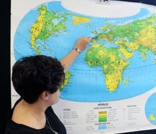 Laura Kustra, world history teacher is seen pointing at Europe. The curriculum was Eurocentric but the school is moving towards a more inclusive curriculum, according to Kustra.