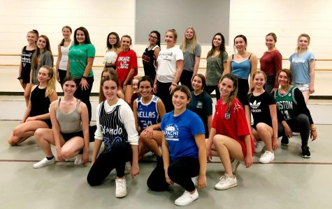 """The Orchesis team poses for a photo during a rehearsal. """"[Orchesis is] a place where you can put yourself and your dancing out there, and not have other people get into your feelings,"""" Emily Rosenfeld, senior and Orchesis president, said. """"I wish more people would dance so they could experience this type of creativity and this outlet."""""""