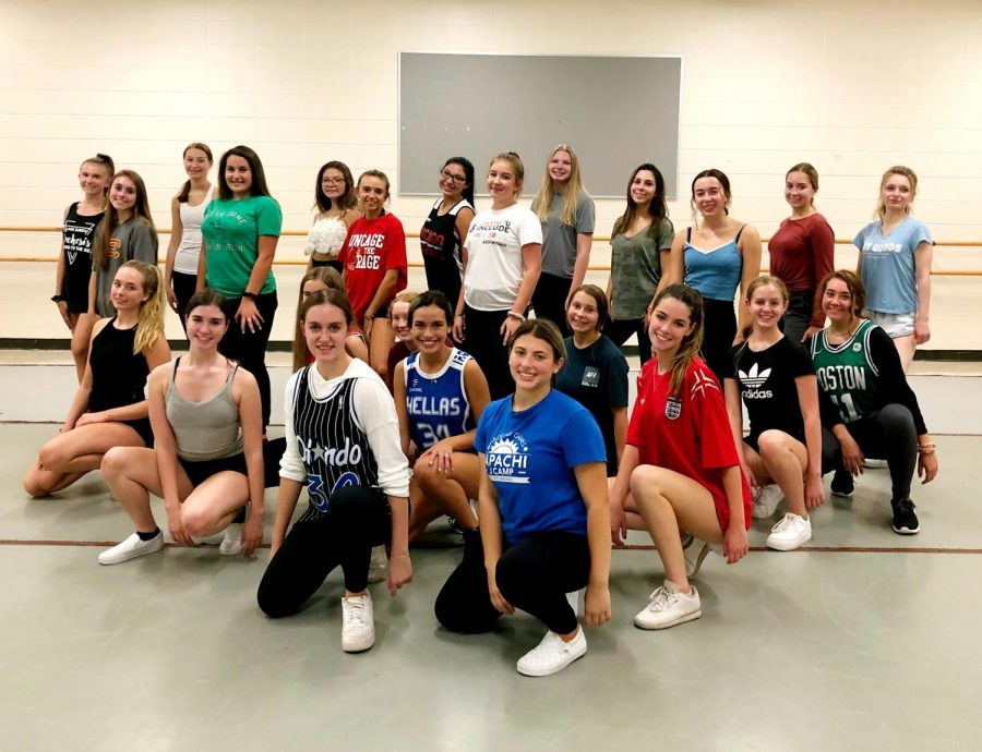 "The Orchesis team poses for a photo during a rehearsal. ""[Orchesis is] a place where you can put yourself and your dancing out there, and not have other people get into your feelings,"" Emily Rosenfeld, senior and Orchesis president, said. ""I wish more people would dance so they could experience this type of creativity and this outlet."""