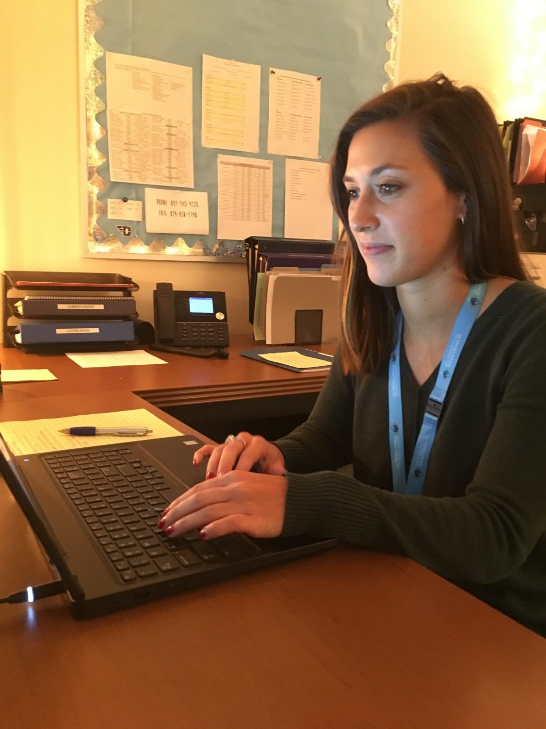 Levato often works on her computer responding to students and staff through email.