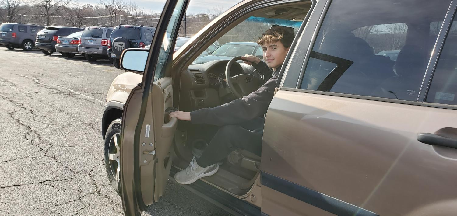 Zach Dayton, senior is about to drive away in his car. He has had his license for over a year and a half and he now drives himself everywhere.