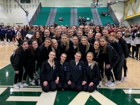 The Poms team stands together after winning first place at the Stevenson Invite. The Poms team has high expectation after returning as State Champions for two consecutive years.