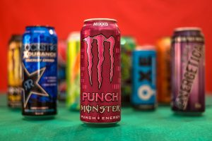 Pictured here are some popular energy drinks like Monster, Bang, and Red Bull that teenagers find themselves drinking due to the fruity flavors and high caffeine levels.