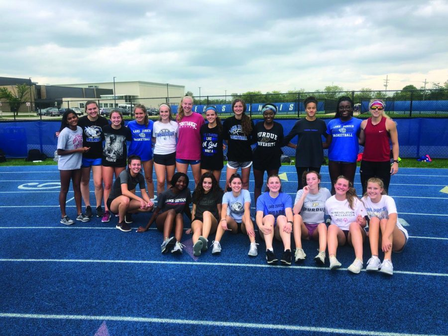 The LZ Speed Club stand together after a workout. Kauffman believes the club has brought the school closer together.