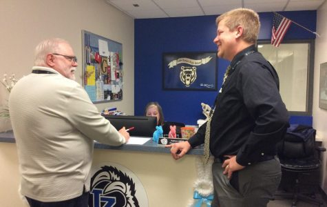 Principal Bo Vossel, right, submitted his resignation in November for undisclosed reasons. An interim principal, who was approved by the Board of Education last week, will fulfill the vacancy starting this month.