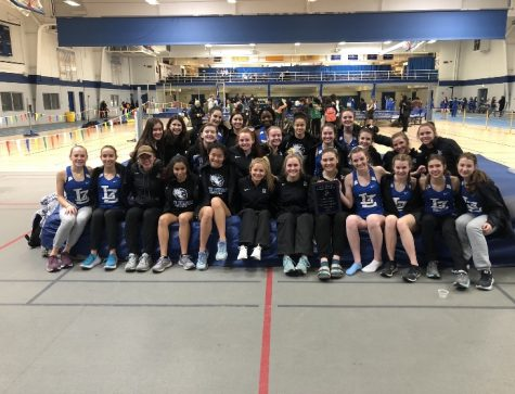 The Girls Track and Field team stands together after the Wheeling Meet on February 29. The team won the meet with a score of 88.5