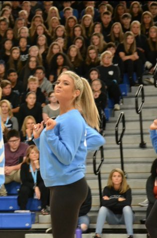 Nicole Albright, junior, dances at the 2019 homecoming assembly. She says she has developed a bond with her Poms team through dance.