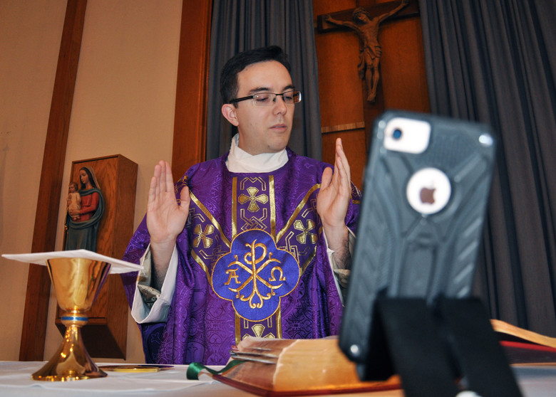 Priest broadcasts mass through cell phone. For many religious people. these virtual gatherings have been a source of comfort and normalcy.