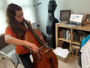 Due to social distancing, music students at home have been doing private lessons remotely at home. Louisa Hagen, freshman, prepares to video chat with her teacher through Zoom right before her private lesson.