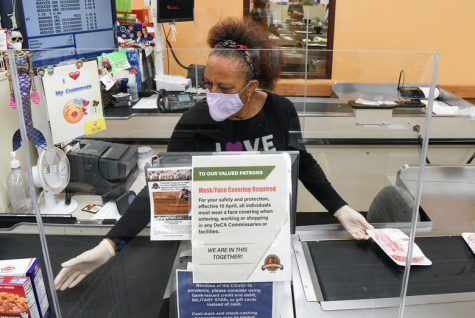 Many grocery store workers have had to adjust to the new changes of masks, gloves and protective barriers between customers as additional measures to keep customers and workers safe.