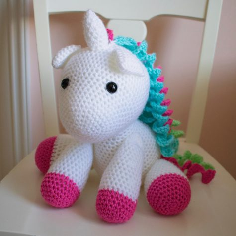 "Cassidy Kalamaras, displays a favorite product of hers. ""I love the unicorn. I make these unicorns and it"