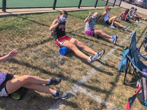 Girls on the cross country team are assigned their own squares that they must stay in when  not running in order to effectively stay six feet apart from each other. According to Jeremy Kauffman, Head Girls Cross Country Coach, these regulations are important as they allow the girls to have a season at all.