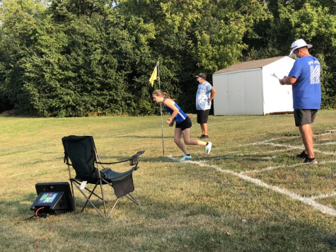 A Girls Cross Country team member gets set to start her race at a meet in the backfield of the school. Each runner starts the race individually this year as a result of COVID-19 and then the teams compare times at the end to determine the winner.